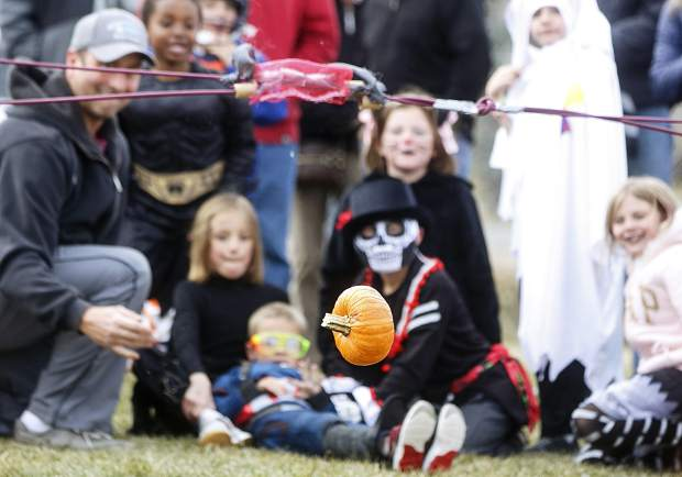 A pumpkin is airborne launched by a catapult Friday, Oct. 27, in Frisco.