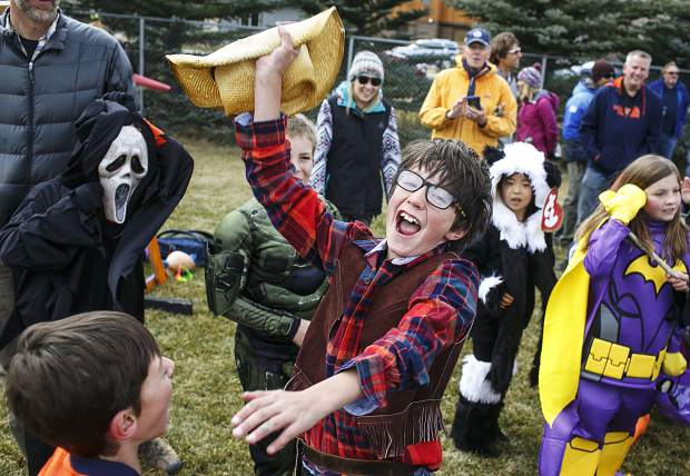 Frisco Elementary School fourth grader Leo Sterk celebrates after winning the pumpkin catapult contest with Mrs. Robinson's class Friday, Oct. 27, in Frisco.