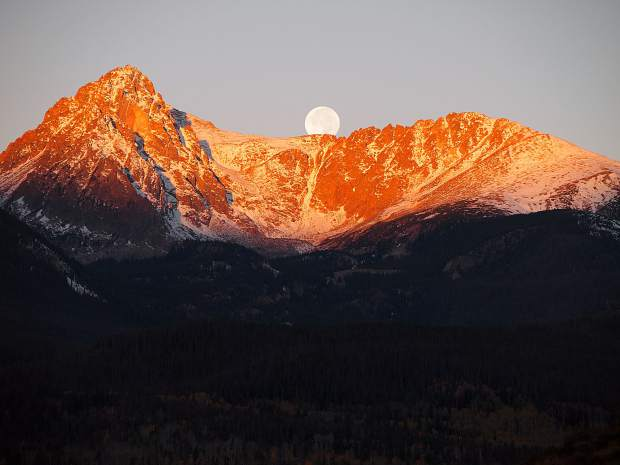 Full moon setting over Mount Silverthorne on Friday morning.