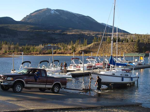 A sunny afternoon at the Frisco Marina as boats take off the water as the sun starts to go down.