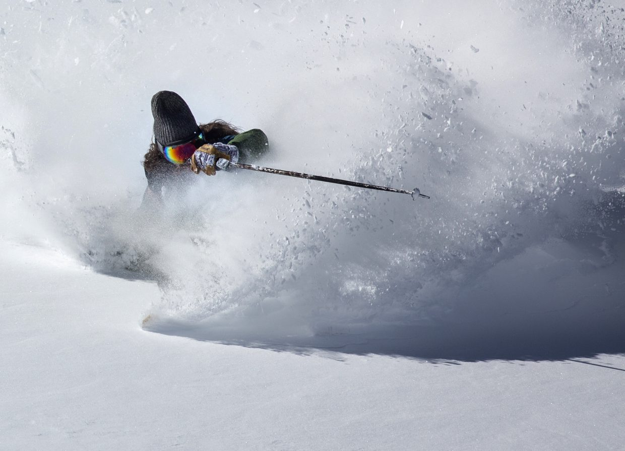 Dave Holten makes a ski turn in fresh snow at Loveland Pass Tuesday, Oct. 3.