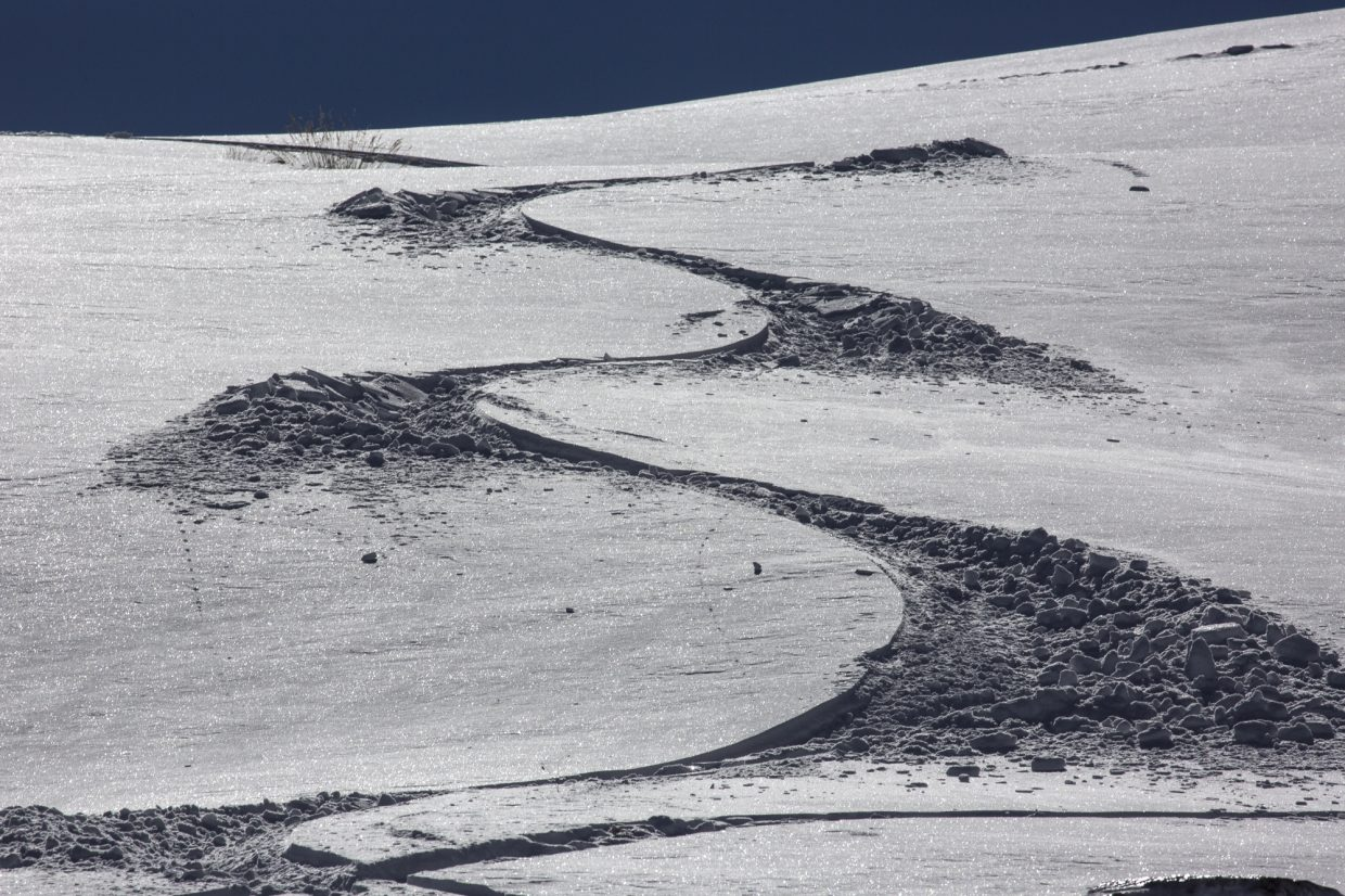 Carved turns in snow created by a skier Tuesday, Oct. 3, at Loveland Pass.