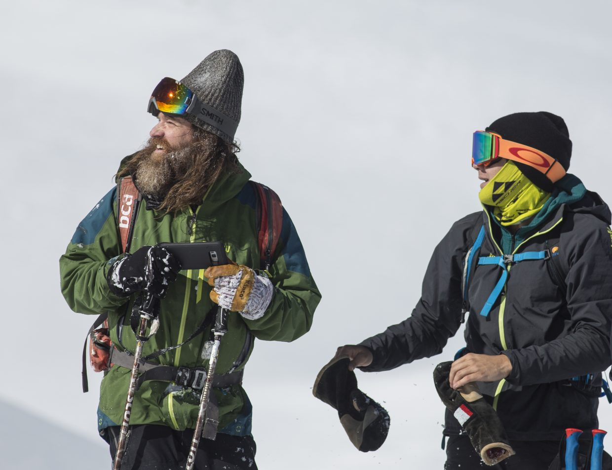 Skiers Dave Holten, left, and Andrew Benaquista look back at their ski routes at Loveland Pass Tuesday, Oct. 3.