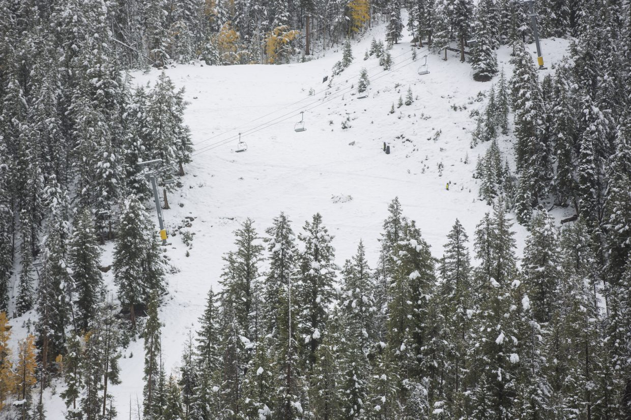 Chairlift not yet running above snow covered runs Monday, Oct. 2, at Keystone.