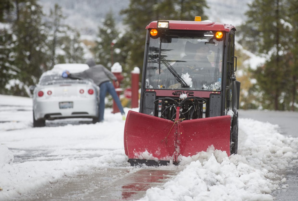 Snow removal machine clears snow off a sidewalk in Dillon Monday, Oct. 2.