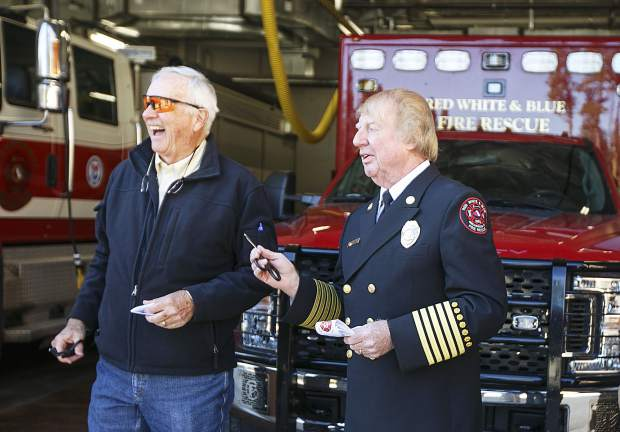 Red White and Blue board president, Arch Gothard, left, and fire chief, Jim Keating, share a laugh during the ribbon cutting of Station 5 on Saturday in Breckenridge.
