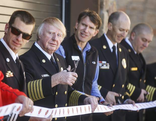 Red, White and Blue Fire chief Jim Keating, second from left, and other officials prepare to cut the ribbon for the new Station 5 Saturday in Breckenridge.