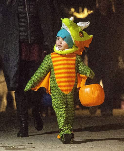 A trick-or-treater Tuesday evening, Oct. 31, along Main Street in Frisco.
