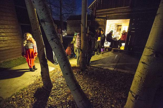 Trick-or-Treaters visit Historic Park Tuesday evening, Oct. 31, along Main Street in Frisco.