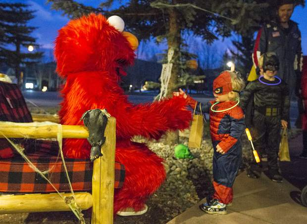 Jasper Boyd, as Spiderman, interacts with Elmo in front of Alpine Accents Consignments store while trick-or-treating Tuesday evening, Oct. 31, along Main Street in Frisco.
