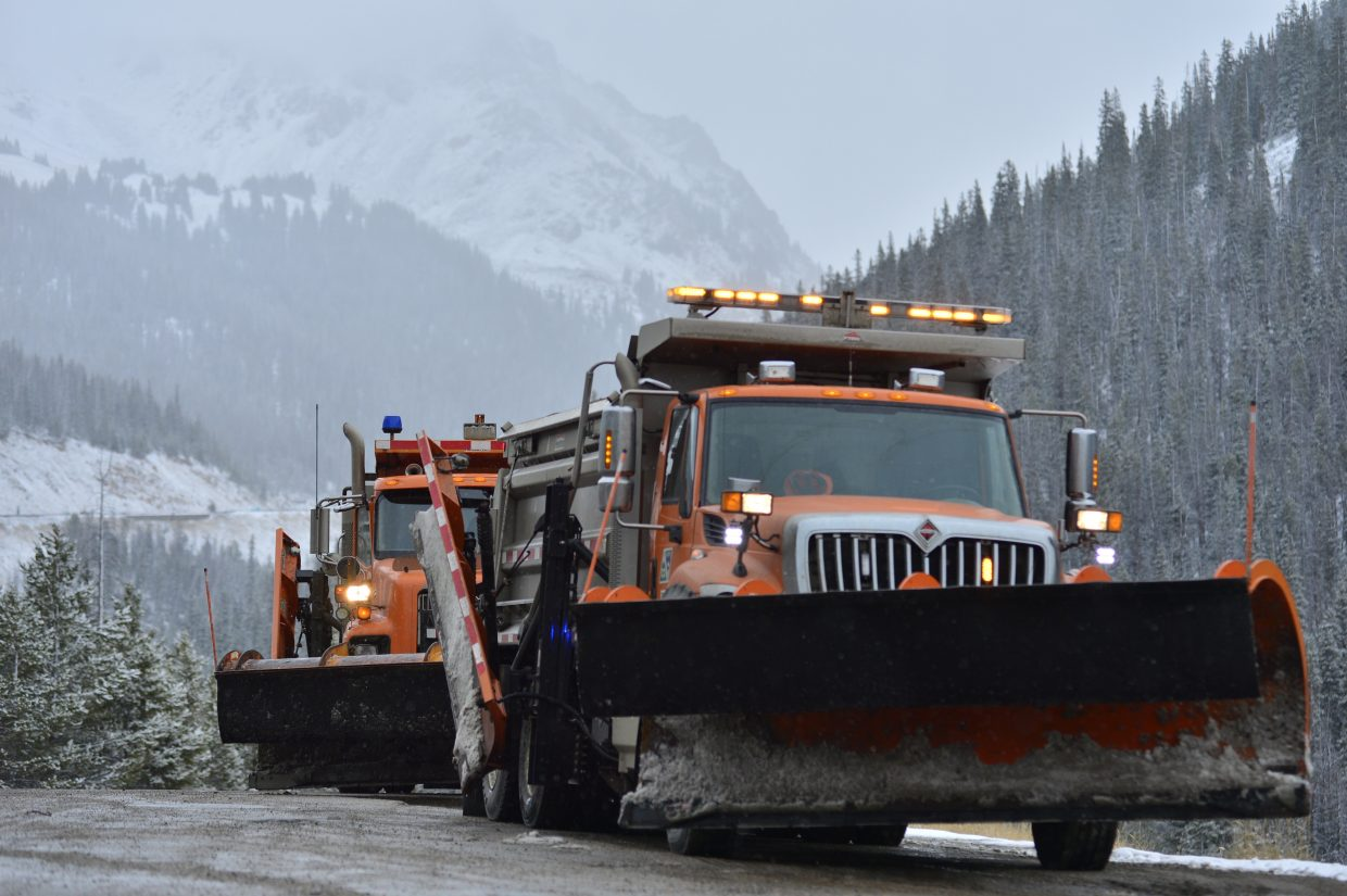 Snowplows sit off to the side of Interstate 70 on Saturday, just west of the Eisenhower Tunnel before Silverthorne.
