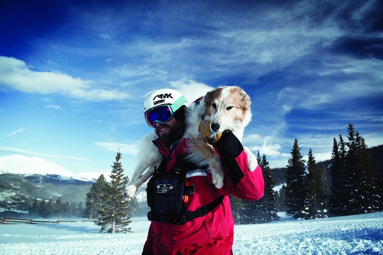 Tali hitches a ride with a ski patroller Hunter Mortensen at Breckenridge Ski Resort.