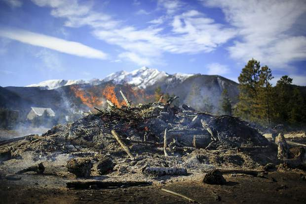 Flames in a burning slash pile Friday, Nov. 3, at the Frisco Peninsula during the annual Colorado Forest Collaboratives Summit.