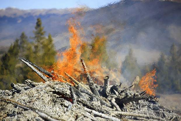 Flames in a burning slash pile Friday, Nov. 3, at the Frisco Peninsula.