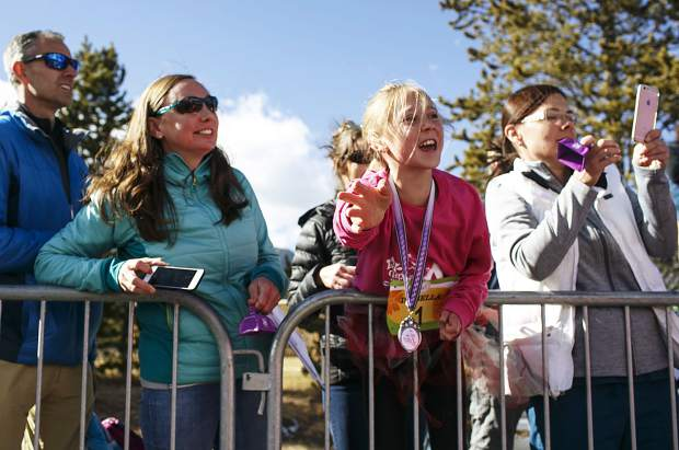 Fans cheer on the participants in the