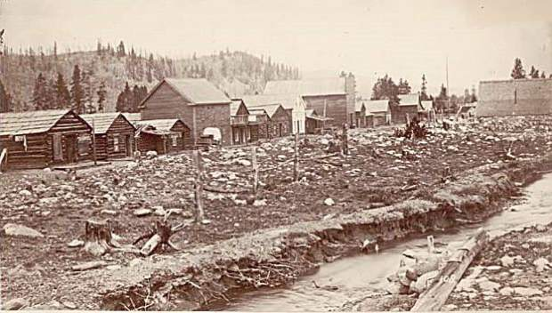 Breckenridge, circa mid-1860s. Wooden structures lined Main Street. Sawmills cut the lumber harvested from nearby hillsides to construct the wooden buildings. The ditch in the foreground brought water to placering operations surrounding the town.