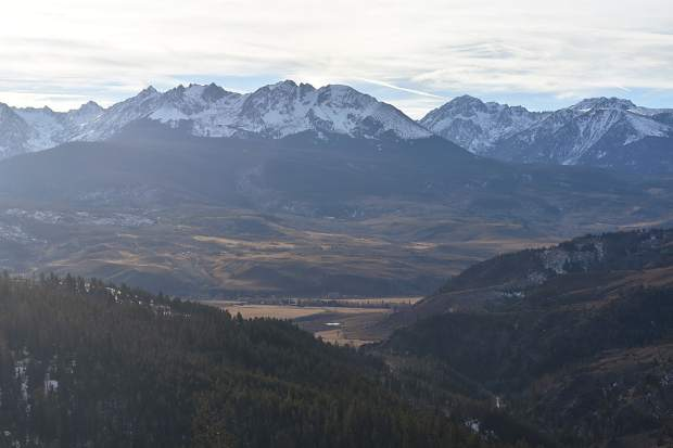 The snowcapped Eagles Nest Wilderness and Gore Range are in view to the east as seen from Ute Pass.