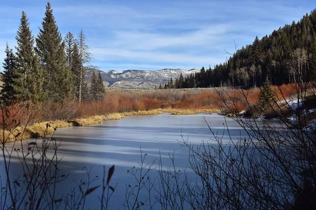 The view to the northeast from the trail surrounding the perimeter of Lower Cataract Lake, a portion of the Williams Fork Mountains in view in the distance.