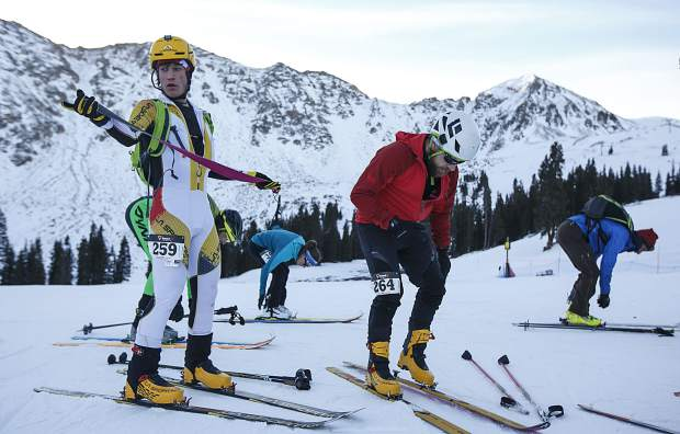 Ski mountaineering competitors transition to downhill mode during the uphill challenge race Tuesday morning, Nov. 14, at Arapahoe Basin.