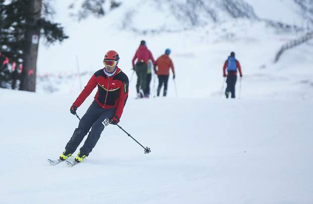 Ski mountaineering competitor skis down for another uphill lap Tuesday morning, Nov. 14, at Arapahoe Basin.