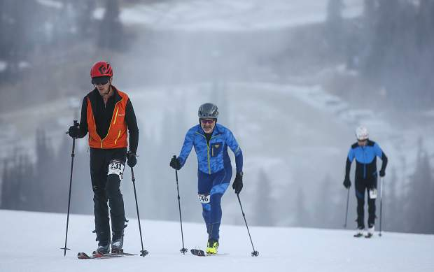 Ski mountaineering competitors hike uphill lap with use of skins attached to bottom of the skis to compete for most laps in one hour Tuesday morning, Nov. 14, at Arapahoe Basin.