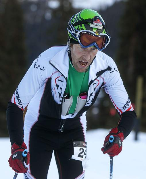 Rise and Shine Rando Race Series competitor Todd Olsen catches breath while uphilling towards mid-mountain at Arapahoe Basin for multiple laps during the race Tuesday morning, Nov. 14.