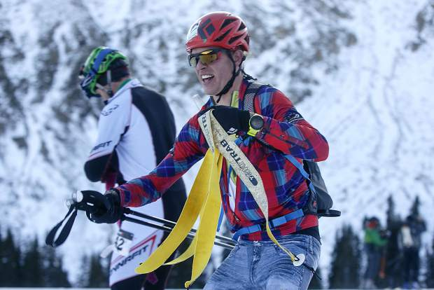 Ski mountaineering competitor Mark Koob moves quickly to ski downhill for a final lap while carrying his skins during the race Tuesday morning, Nov. 14, at Arapahoe Basin.