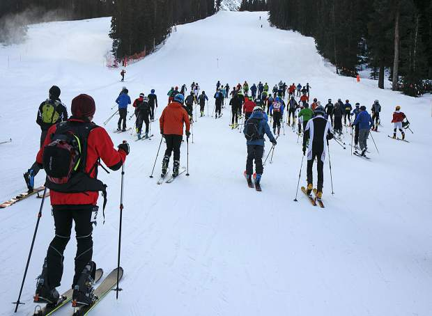 Participants, young and old, take off on High Noon run for the uphill challenge in the