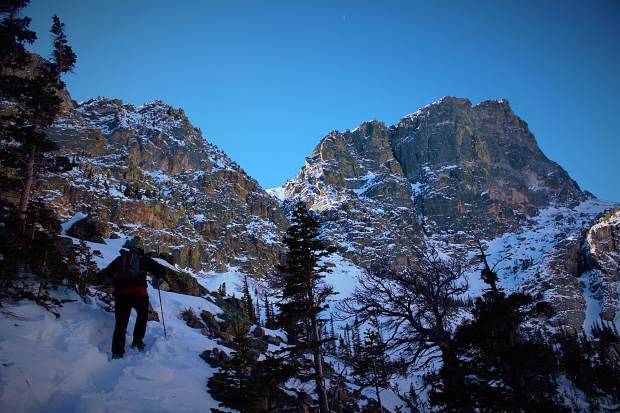 Summit Daily News sports and outdoors editor Antonio Olivero hikes up some early season deep snowpack to get a better view down to Emerald Lake at Rocky Mountain National Park on Sunday Nov. 12, 2017