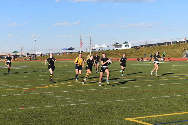 The Summit Black girls rugby team runs in for a score during their state semifinal match versus Fort Collins Saturday afternoon in Westminster.