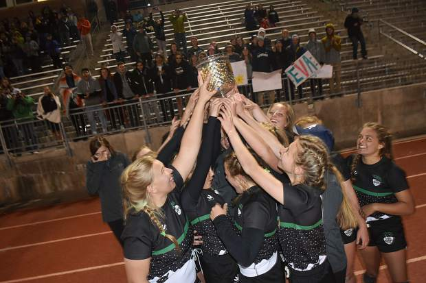 The Summit Black rugby team hoists the state championship trophy after they won their 10th consecutive state title, by the score of 50-7, over the Westside Swarm of Denver in Westminster Saturday evening.