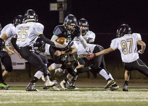 Summit High School running back Noah Martens runs with the ball during the game against Battle Mountain High School Friday, Nov. 3, in Frisco.