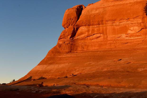 Beautiful early morning light illuminates the red rock wall by our campsite.