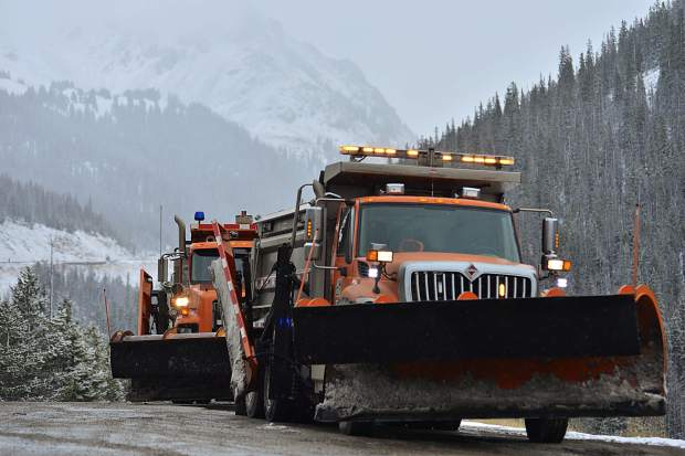 Snowplows sit off to the side of Interstate 70, just west of the Eisenhower Tunnel before Silverthorne, on Saturday as winter weather settles into the area. According to an NWS forecaster, Summit County could receive 3-6 inches by Sunday morning with the storm lingering through Tuesday.