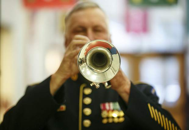 Taps played by Mike McGhee during the Veteran's Day celebration at Frisco Elementary School Friday, Nov. 10, in Frisco.