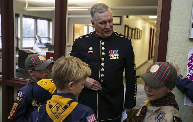Mike McGhee interacts with Boy Scout Troop members following the Veteran's Day Celebration at Frisco Elementary School Friday, Nov. 10, in Frisco.