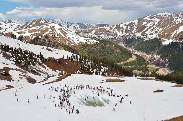 The early-summer sight of Lake Reveal at Arapahoe Basin, with views of rapidly melting snowpack on the Continental Divide. In late May and early June — just in time for A-Basin's extended weekend June 9-11 — the