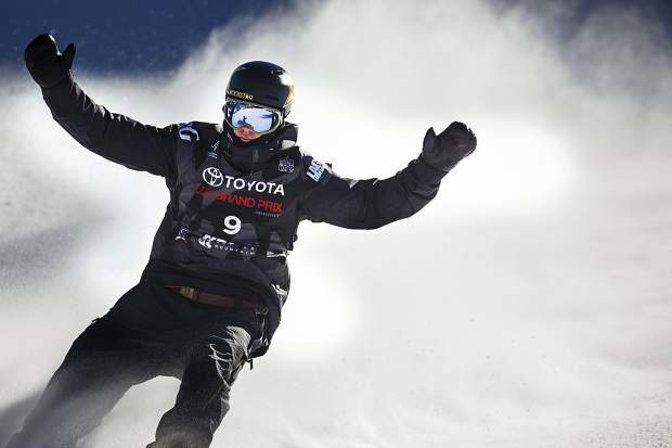 Mons Roisland of Norway raise his arms following his run in the big air final during the U.S. Grand Prix event Sunday, Dec. 10, at Copper Mountain.