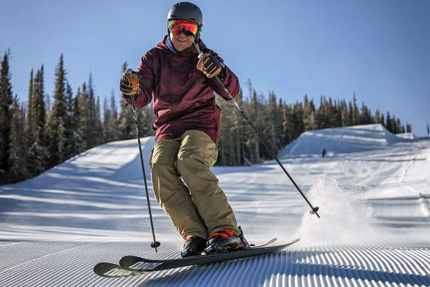 A skier makes first turns on freshly groomed powder at Keystone Resort Friday morning.