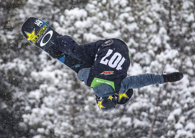Jake Pates of the United States competes in the snowboard superpipe qualifiers during the Dew Tour event Thursday, Dec. 14, at Breckenridge Ski Resort. Pates, of Eagle, qualified in second place for Friday's final with a score of 81.66.