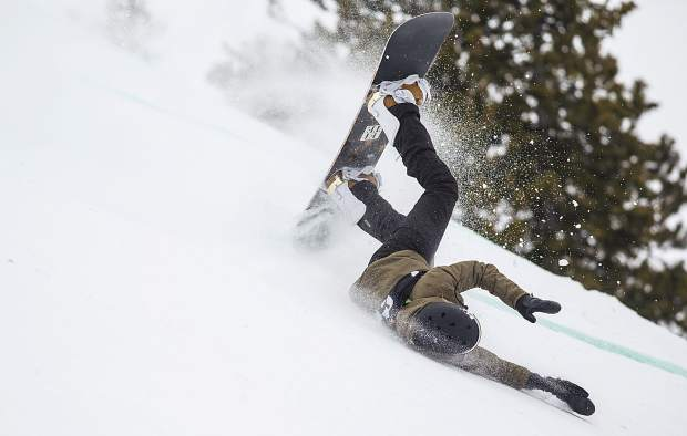 Laurie Blouin of Canada takes a fall in the slopestyle finals during the Dew Tour event Saturday, Dec. 16, at Breckenridge Ski Resort.