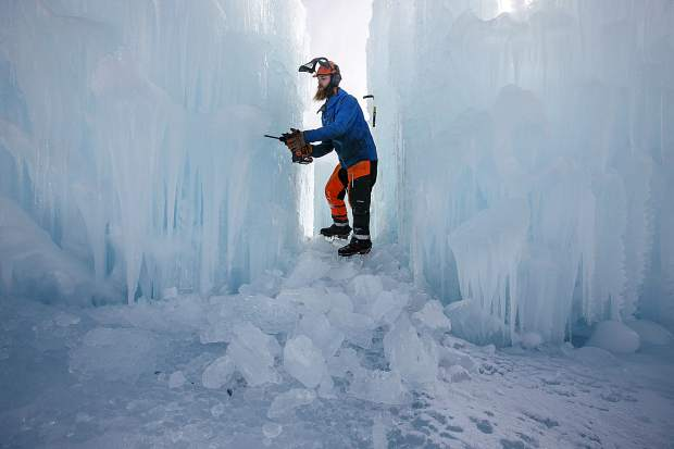 Keith Heintzelinan, Ice Castles' assistant manager, carves out chunks of ice with machinery Wednesday, Dec. 20, at the site in Dillon Town Park.