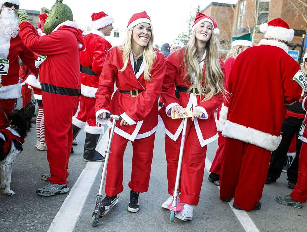 A pair of Santa Clauses on scooters on Main Street Saturday, Dec. 2, in Breckenridge.