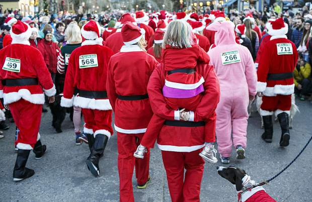 Participants dressed as Santa Clauses take part in the Race of the Santas Saturday, Dec. 2, on Main Street in Breckenridge.
