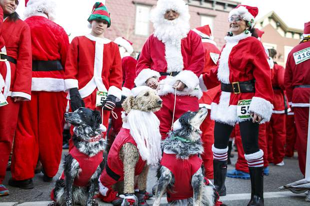 Some four-legged Santa Clauses take part in the Race of the Santas Saturday, Dec. 2, on Main Street in Breckenridge.