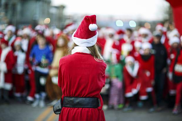 A Santa Clause among others take part in the Race of the Santas Saturday, Dec. 2, on Main Street in Breckenridge.