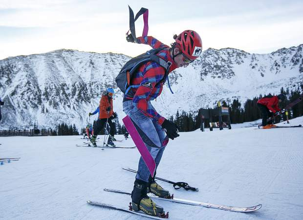 Ski mountaineering competitor Mark Koob takes off the skins from the skis to go downhill during the race Tuesday morning, Nov. 14, at Arapahoe Basin.