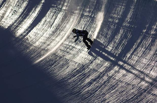 A snowboarder competes the superpipe finals Friday, Dec. 15, at Breckenridge Ski Resort.