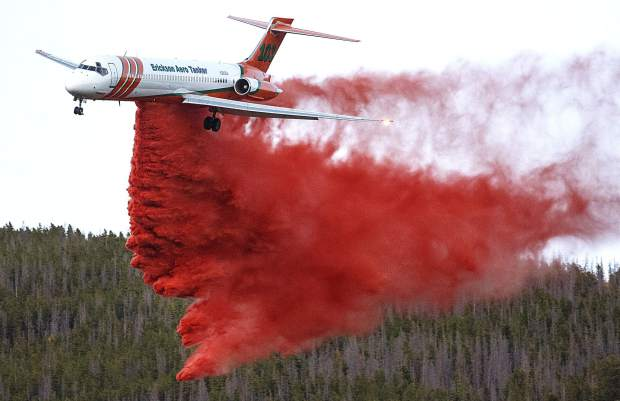 An airtanker drops fire retardant slurry on a fire along Tenderfoot Trail Road Monday, Sept. 18, in Dillon.