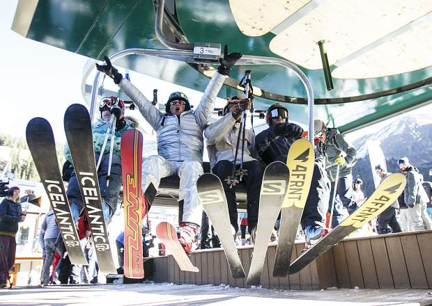 Skiers react on their first chairlift ride of the 2017/2018 season Friday, Oct. 13, at Arapahoe Basin Ski Resort.